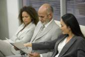 Businesspeople looking at paperwork — Stock Photo
