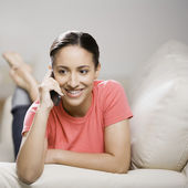 Mixed Race woman talking on cell phone — Stock Photo