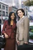 Multi-ethnic businesswomen in urban area — Stock Photo
