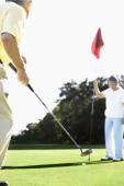 Senior Asian couple playing golf — Stock Photo