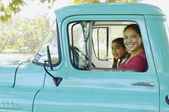 Hispanic mother and daughter driving truck — Foto Stock