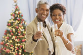 African couple toasting with champagne — Stock Photo