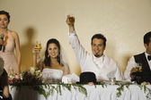Hispanic newlyweds toasting with champagne — Stockfoto