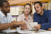 Multi-ethnic couple looking at swatches — Stockfoto
