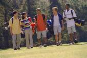 Multi-ethnic friends on golf course — Stock Photo