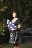 Woman holding folded American flag — Stock Photo