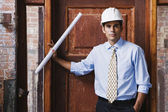 Hispanic businessman wearing hard hat — Stock Photo