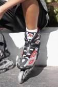 Pacific Islander boy wearing roller blades — Stock Photo