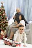 Hispanic boy playing on Christmas — Stock Photo