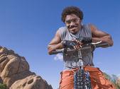 African man on mountain bike — Foto Stock