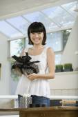 Asian woman holding gift — Stock Photo