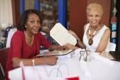 Senior African American women at restaurant — Stock Photo