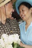 Senior Asian couple smiling at each other — Stock Photo