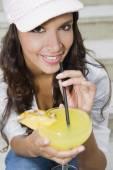 Hispanic woman drinking cocktail — Stock Photo