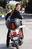 Asian businesswoman riding motor scooter — Stock Photo