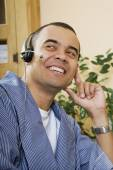 Pacific Islander man wearing headset — Stock Photo