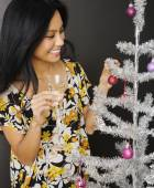 Pacific Islander woman decorating Christmas tree — Stock Photo