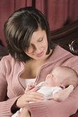 Hispanic mother holding baby — Stock Photo