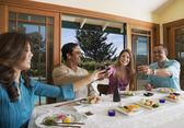Multi-ethnic couples eating sushi — Stock Photo