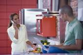 African American couple in kitchen — Stock Photo