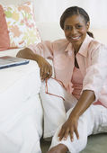 Senior African American woman next to laptop — Stockfoto