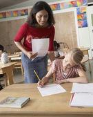 Indian female teacher helping student — Stock Photo