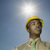 African American man wearing hard hat — Stock Photo