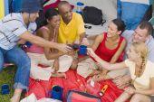 Multi-ethnic friends toasting at campsite — Stock Photo