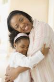 African mother hugging daughter — Stock Photo