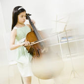 Asian girl playing cello — Stock Photo