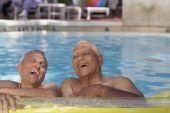 Multi-ethnic senior men in swimming pool — Stock Photo