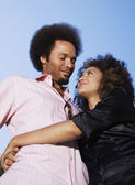 African couple hugging — Stock Photo