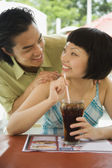 Asian couple smiling at each other — Stockfoto