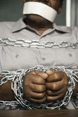African American man chained and gagged — Stock Photo