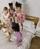 Multi-ethnic girls having slumber party — Stock Photo