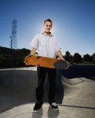 Portuguese young man holding skateboard — Stock Photo