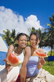 Hispanic women eating watermelon — Stock Photo