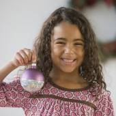 African girl holding Christmas ornament — Stock Photo