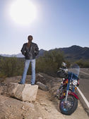 Hispanic woman standing next to motorcycle — Stock Photo