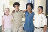 Multi-ethnic children standing arm in arm — Stock Photo
