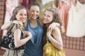 Multi-ethnic teenaged girls hugging — Stock Photo