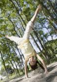 Mixed Race girl doing cartwheel — Stock Photo