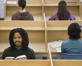 African man reading at library — Stock Photo