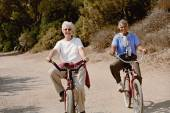 Multi-ethnic senior women riding bicycles — Foto Stock