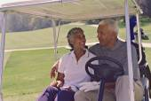 Senior African American couple in golf cart — Stock Photo