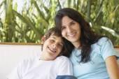 Hispanic mother and son hugging — Stock Photo