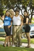 Hispanic man with three women — Foto Stock