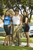 Hispanic man with three women — Stok fotoğraf