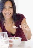 Pacific Islander woman eating cereal — Stock Photo