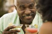 Senior African man smiling with cocktail — Stock Photo